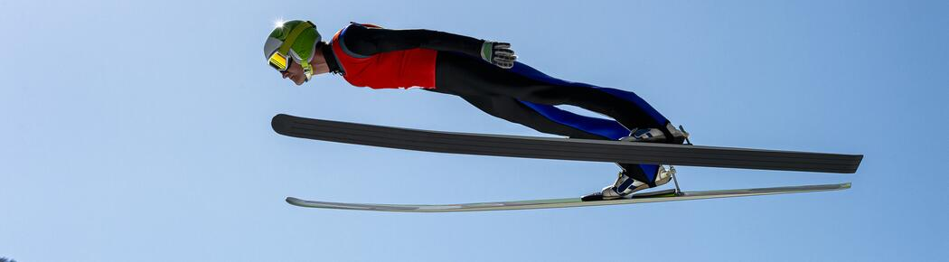 Side View of Male Ski Jumper in Mid-air